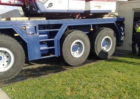 PolyTrac Bog Mats being used under a 50T truck